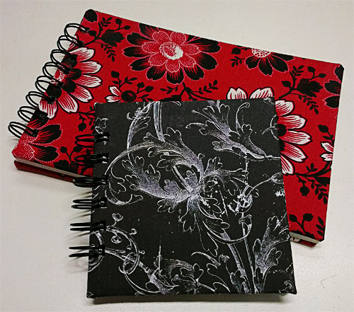 Journals made with Bind-It-All, as examples for a class I had.